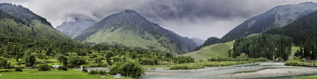 Landscape Panorama of Betaab Valley, Anantnag, Jannu and Kashmir. Majestic Himalayas, sky covered with clouds, lush green grass spread on the slopes and the cold Royalty Free Stock Image