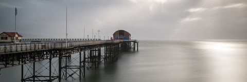 Landscape panorama long exposure peaceful image of Mumbles pier Stock Photography