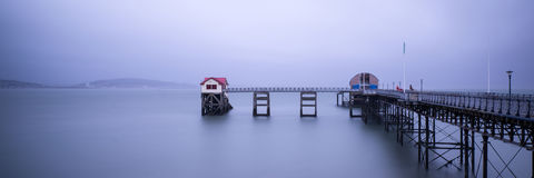 Landscape panorama long exposure peaceful image of Mumbles pier Royalty Free Stock Photo