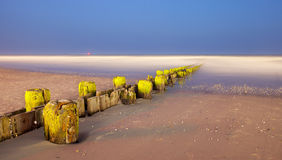 Landscape panorama of old pier posts on the beach Royalty Free Stock Photography