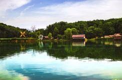 Landscape panorama with windmills. And lake royalty free stock image