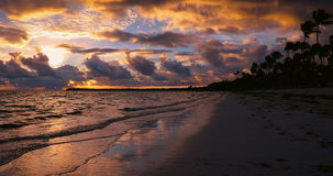 Landscape of paradise tropical beach. Beautiful sunrise and dramatic cloudscape. Punta Cana stock footage