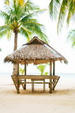 Landscape of paradise tropical island with palms cottages and white sand beach Stock Images