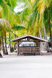 Landscape of paradise tropical island with palms cottages and white sand beach Stock Photography
