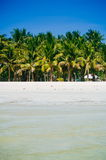 Landscape of paradise tropical island with palms and white sand beach Royalty Free Stock Photo