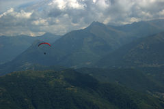 Landscape and paraglide in the mountains Royalty Free Stock Photos