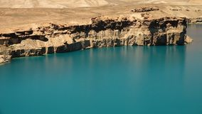 Landscape of peaceful blue freshwater lake basin. Surrounded by travertine mountains. Band-e Amir Lakes. Band-e Amir National Park, Bamyan Province, Afghanistan stock video footage