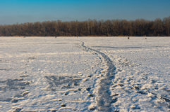 Landscape with pedestrian path over frozen Dnepr river in the same city, Ukraine Royalty Free Stock Images