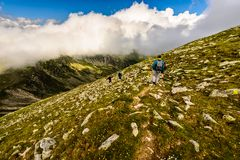 Landscape with people exploring the mountains Stock Photo