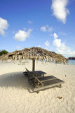 Landscape photo of beach hut in Mabul Island ocean with blue s Royalty Free Stock Image