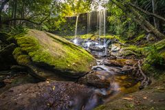 The landscape photo, beautiful rainforest waterfall in deep forest at Phu Kradueng National Park Stock Images