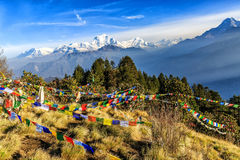 Prayer flag at Poon hill in Nepal. Landscape photo of beautiful sunrise and prayer flags on Poon hill in nepal stock photos