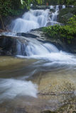 Landscape photo. beautiful waterfall in rainforest Stock Photos