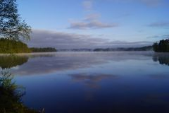 Landscape Photo of Body of Water Surrounded by Trees Royalty Free Stock Photos