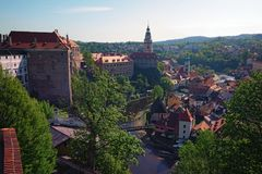 Landscape photo of Cesky Krumlov castle with high tower, part of historical center of Cesky Krumlov and beautiful Vltava river royalty free stock image