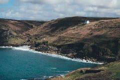 Landscape Photo of Coastline and Hills Stock Images