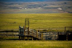 Corral. This is a landscape photo of a corral, an open field, and  hills Royalty Free Stock Photography
