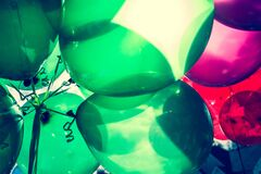 Landscape Photo Of Green and Red Balloons Stock Images