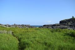 Landscape photo leading to the ocean stock photography