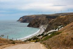 A landscape photo of Morgans Beach Cape Jervis showing the grave. L access road and the starfish windfarm in the distance located in South Australia on 1st royalty free stock images