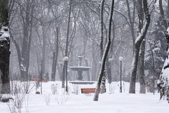 Landscape photo of morning snowfall in the Mariinsky park. Old fountain in the background. High layer of snow on the ground. Stock Images