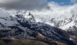 Landscape photo snowy mountain top a sunny and covered with clouds, Mestia Royalty Free Stock Images