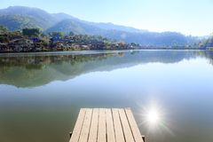 Landscape photo of wooden bridge morning with white fog over lake. Landscape photo of wooden bridge morning with white fog over lake at Ban Rak Thai village Royalty Free Stock Images