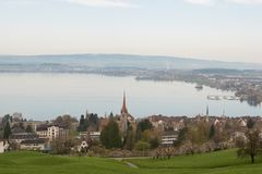 Landscape photograph of small city Zug near lake in morning in Switzerland. Aerial image of Zug city. With lake Stock Images