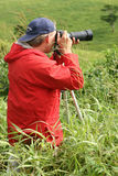 The Landscape Photographer. Zooming to capture the scene of interest Royalty Free Stock Images