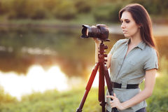 Landscape Photographer with Camera on a Tripod Royalty Free Stock Images