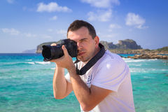 Landscape photographer with camera Stock Image