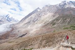 Landscape photographer shooting a glacier, working in Himalayas mountain Royalty Free Stock Photography