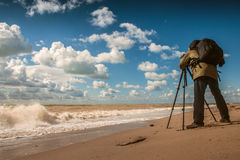 Landscape photographer work on sea coast Stock Images