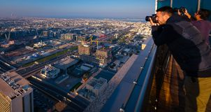 Landscape Photographers on rooftops in Dubai. Give Dubai`s development as a modern and luxury city and home to the worlds tallest building. The city is flocked stock image