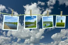 Landscape photographs hanging on a clothesline Royalty Free Stock Photo