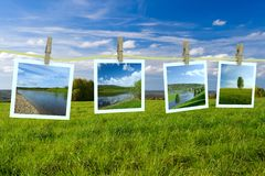 Landscape photographs hanging on a clothesline Stock Image