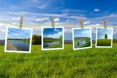 Landscape photographs hanging on a clothesline Stock Image