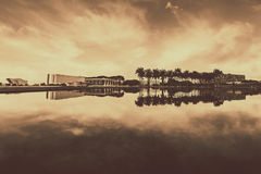 Landscape Photography of Buildings and Trees Near Body of Water in Sepia Effects Stock Photos