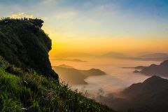 Landscape Photography of Cliff With Sea of Clouds during Golden Hour stock photography