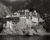 Landscape Photography of Gray and White House Near Mountain Cliffs Above Body of Water stock images