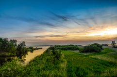 Landscape Photography of Green Grass and Sea royalty free stock images