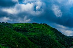 Landscape Photography of Green Mountain Under Cloudy Sky Stock Photos