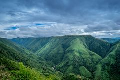 Landscape Photography of Green Mountains Under Cloudy Sky Stock Photography