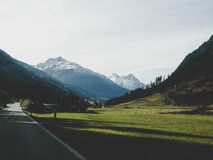 Landscape Photography of Mountains Near Road Stock Photo