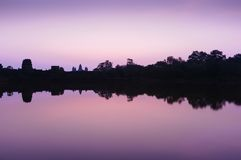 Landscape Photography of Silhouette of Trees and Buildings Under Purple and White Sky Royalty Free Stock Photo
