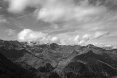 Black and white mountain landsacpe in the Strona Valley. Landscape photography of the Strona valley in the italian alps, with beautiful clouds in movement royalty free stock photos