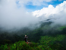 Landscape in Phu Soi Dao National Park, Thailand. Hikers enjoying the sight of a fog cover mountainous landscape located in Phu Soi Dao National Park, Thailand Royalty Free Stock Photos