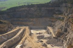 Landscape Picture on the deep opencast stone mine or surface, strip mine. Stock Photography