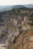 Landscape Picture on the deep opencast stone mine or surface, strip mine. Stock Photo