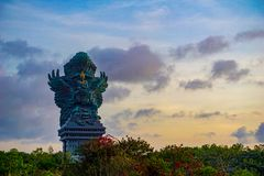 Picture of Garuda statue as Bali landmark with blue sky as a background. Balinese traditional symbol of hindu religion. Landscape picture of Garuda statue as stock photo